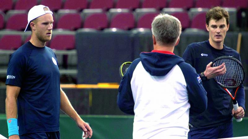 Britian's coach Louis Cayer with Jamie Murray and Dominic Inglot during a  practice session in Ottawa. (Photo: AP)