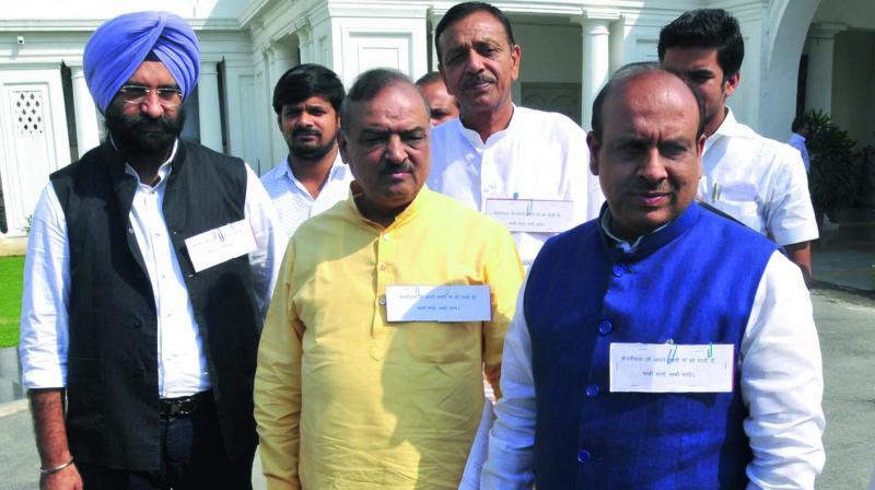 BJP MLAs Manjinder Singh Sirsa and O.P. Sharma with Jagdish Pradhan and Vidender Gupta at the Assembly in New Delhi. (Photo: Bunny Smith)