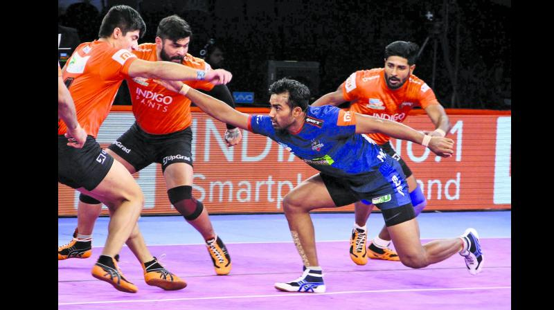 U Mumba defenders try to evade Haryana Steelers raider Monu Goyat  at Dome@NSCI last season