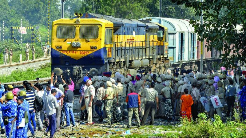 Security on high alert as the first train passes by before resumption of railway services since the train accident in Amritsar. (Photo: PTI)