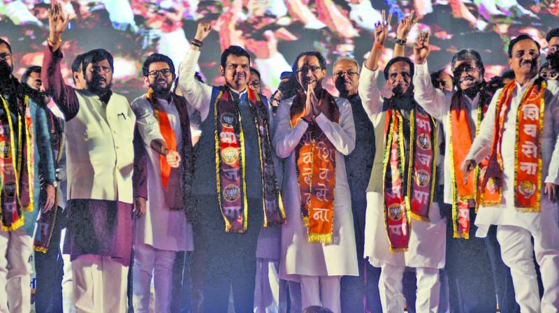 Chief minister Devendra Fadnavis, Shiv Sena chief Uddhav Thackeray and other party leaders at the first campaign meet in Kolhapur on Sunday. (Photo: SHRIPAD NAIK)