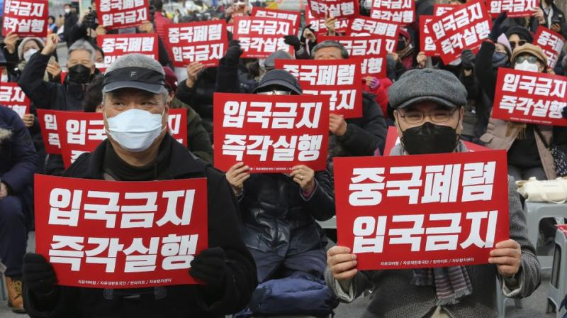 South Korean protesters stage a rally calling for a ban on Chinese people entering South Korea near the presidential Blue House in Seoul, South Korea. AP photo