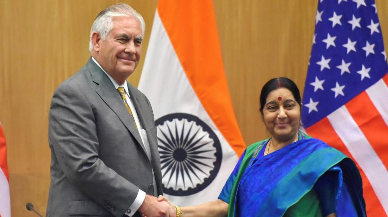 Minister for External Affairs Sushma Swaraj and US Secretary of State Rex Tillerson shake hands after their joint press conference in New Delhi. (Photo: PTI)