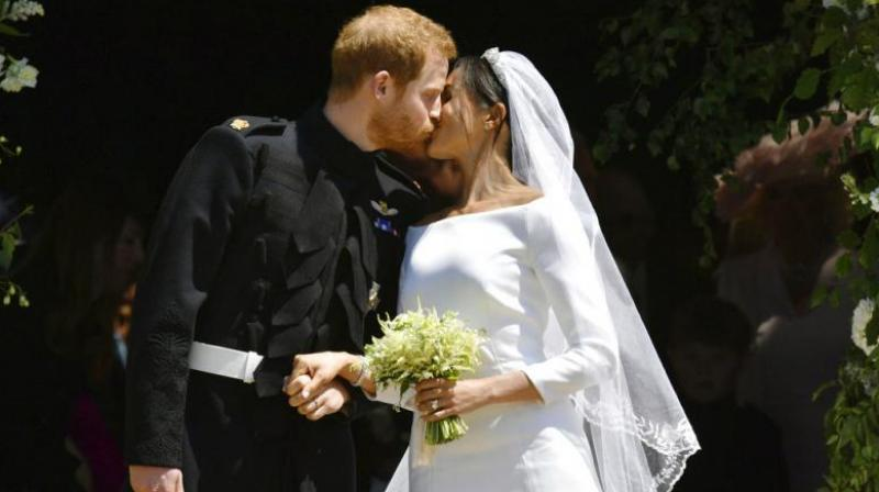 Prince Harry and Meghan Markle leave after their wedding ceremony at St. George's Chapel in Windsor Castle in Windsor, near London. (Photo: AP)