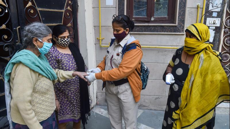 Volunteers use an oximeter to measure the oxygen level during a door-to-door campaign to check symptomatic COVID-19 residents, amid rise in coronavirus cases, in East Delhi, Sunday, Nov. 22, 2020. (PTI)
