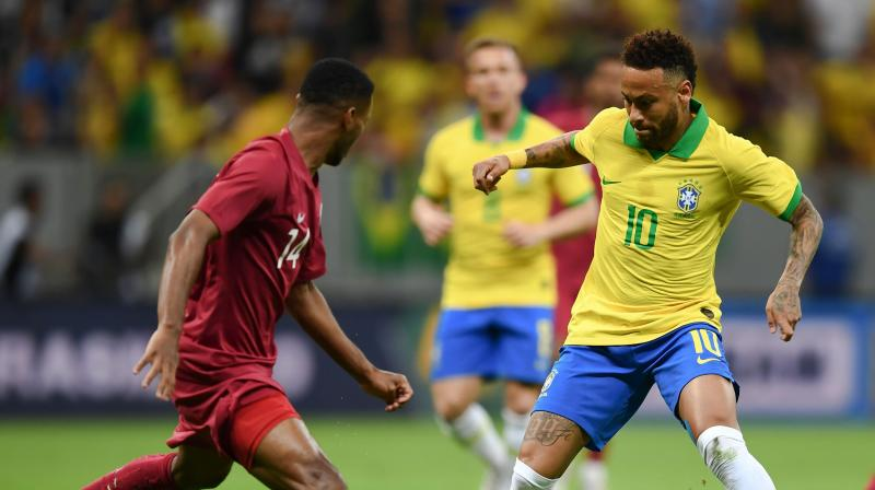 A distraught-looking Neymar was seen covering his face with his hands as he sat on the bench after hobbling from the field in the 20th minute at Brasilia's Mane Garrincha Stadium. (Photo:AFP)