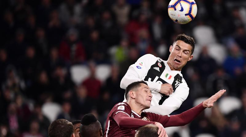 Ronaldo headed in from the cross for his 21st Serie A goal of the season to maintain his side's unbeaten home record in the league. (Photo: AFP)