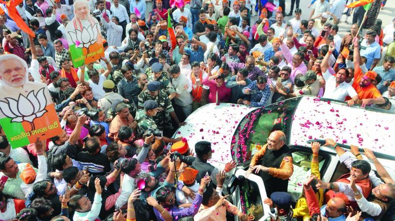 BJP president Amit Shah gets rousing welcomed by party workers outside the party headquarters in New Delhi. (Photo: Biplab Banerjee)