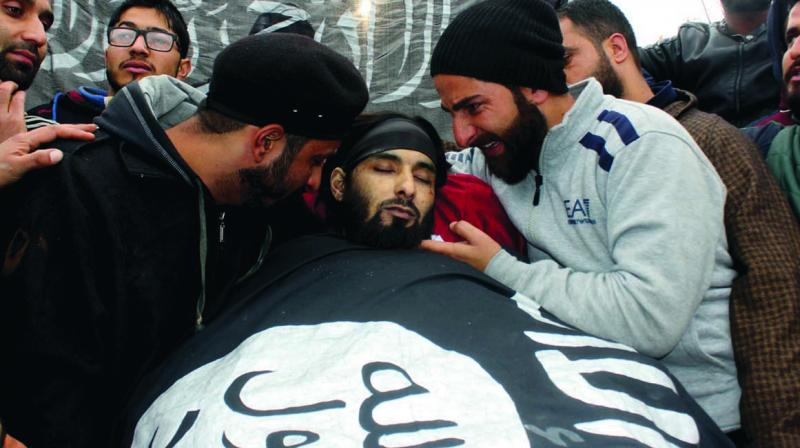 Funeral of militant Mughees Mir whose body was wrapped in an IS flag in Parimpora. (Photo: H.U. Naqash)