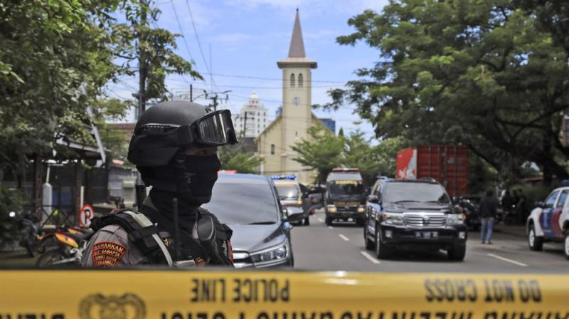 A police officer stands guard near a church where an explosion went off in Makassar, South Sulawesi, Indonesia, Sunday, March 28, 2021. (AP)