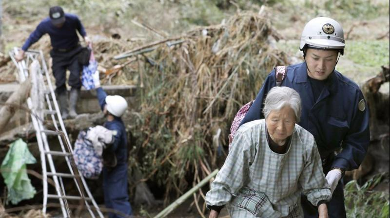 Rescuers in Japan worked into a third day on Tuesday in an increasingly desperate search for survivors of a powerful typhoon that killed nearly 70 people and caused widespread destruction. (Photo: AP)