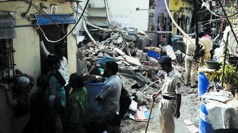 Three persons — Sanjay Wankhede (35), his wife Rekha Wankhede (30) and Sanjay's mother Kasturba Wankhede (65) — were killed and five were injured when a building collapsed due to a cylinder explosion at Maharashtra Nagar slum, in in Mankhurd on Thursday. (Photo: Shripad Naik)