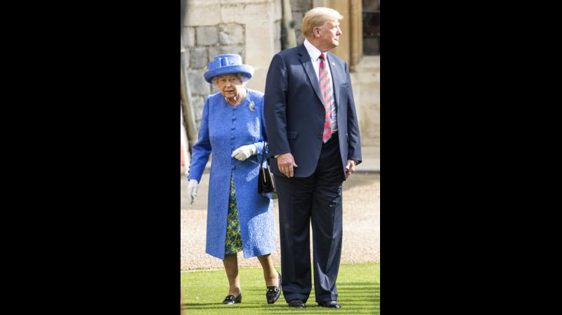 Trump's visit to Windsor Castle further caused controversy when he broke royal protocol by walking in front of the Queen as he discussed the Guard of Honour. (Photo: AP)
