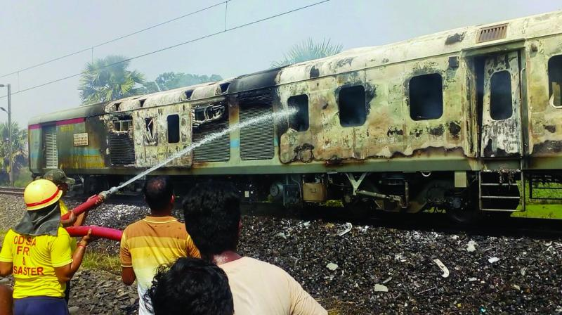 Firefighters attempt to douse a fire that broke out at the generator car of New Delhi-Bhubaneswar Rajdhani Express in Odisha's Balasore district on Saturday. (Photo: PTI)