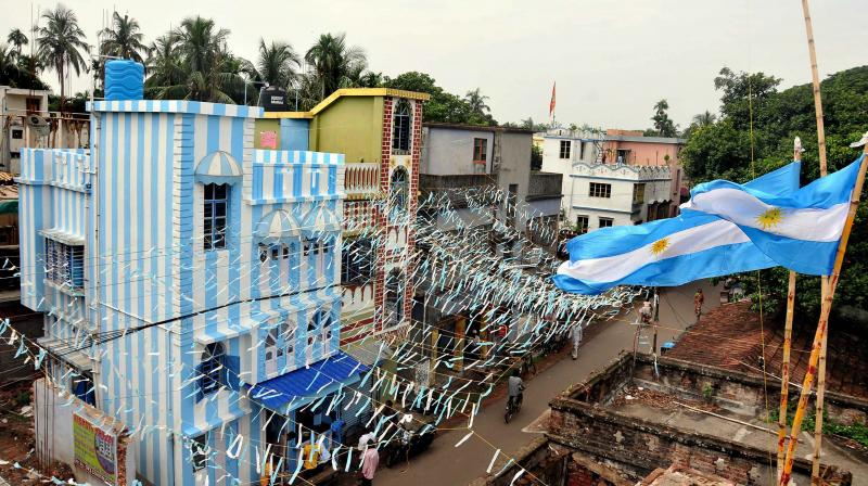 Shib Shankar Patra's three-storeyed apartment painted in blue-and-white ahead of Fifa World Cup 2018 in North 24 Parganas on Sunday. (Photo: PTI)