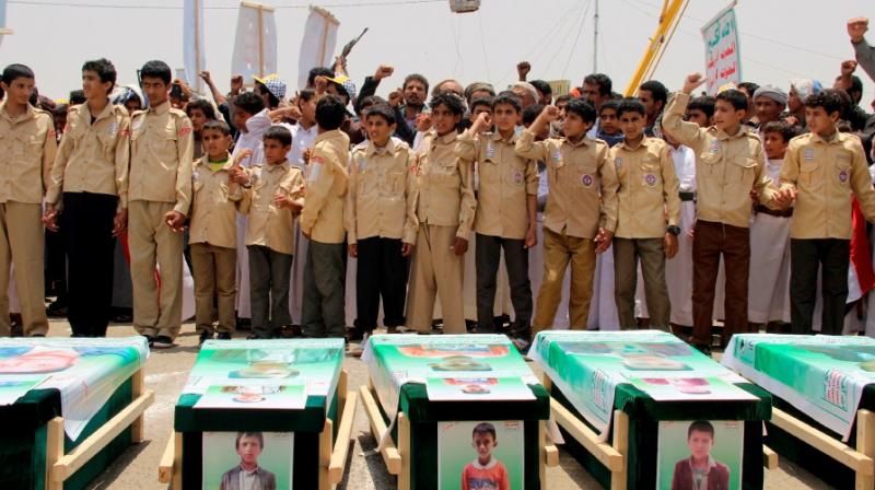 Yemeni children vent anger against Riyadh and Washington on August 13, 2018 as they take part in a mass funeral in the northern Yemeni city of Saada, a stronghold of the Iran-backed Huthi rebels, for children killed in an air strike by the Saudi-led coalition last week. (Photo: AFP)