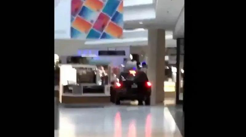 Video posted on social media shows the black Chevy Trailblazer driving through the Woodfield Mall in Schaumburg. (Photo: Screengrab)