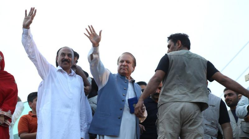 Former Pakistan PM Nawaz Sharif waving to the supporters during his Homecoming rally (Photo: Twitter)