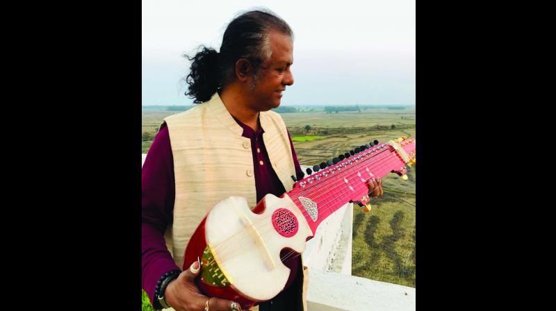 Pt Debashish Bhattacharya with his instrument.