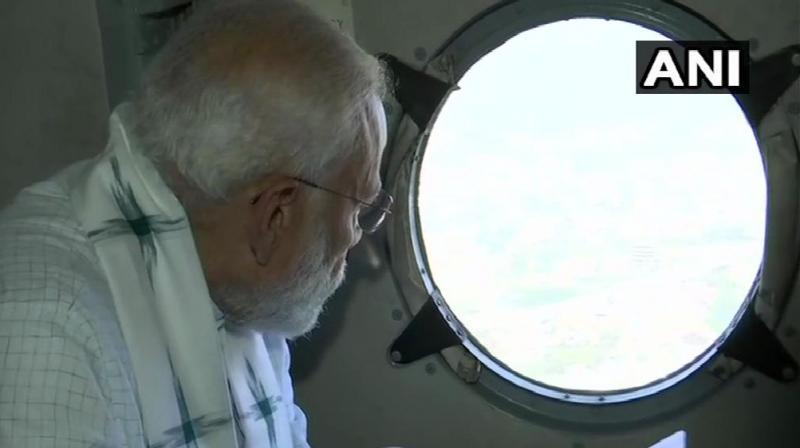 PM Modi carrying out aerial survey in Odisha post cyclone Fani. (Photo: Twitter I ANI)