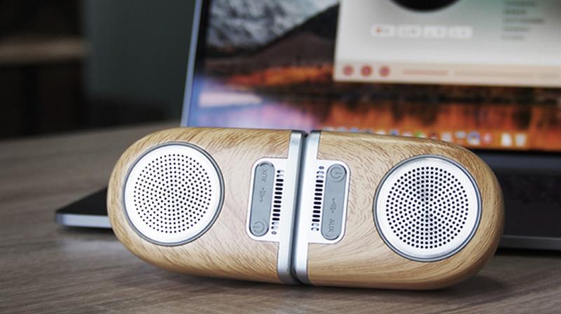 The new speaker flaunts the radio looks with the wood-like body.