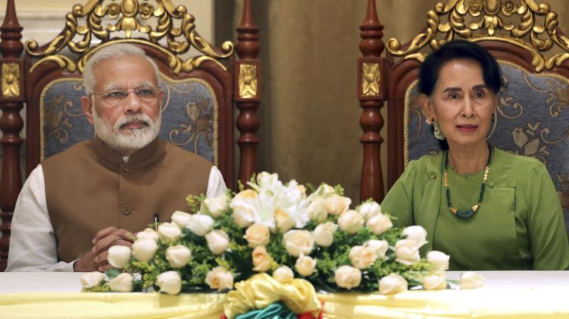 Myanmar's State Counsellor Aung San Suu Kyi, right, and Prime Minister Narendra Modi listens during their signing ceremony of the Memorandum of Understanding (MOU) at the Presidential Palace in Naypyitaw, Myanmar. (Photo: AP/File)