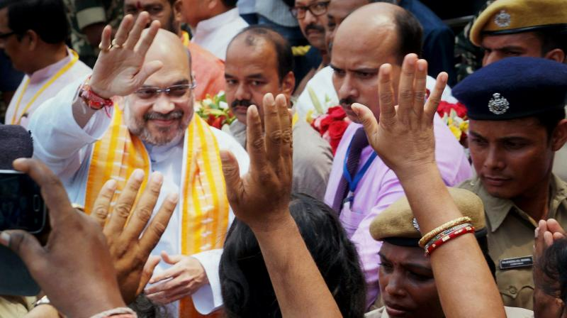 BJP chief Amit Shah is welcomed by supporters on his arrival to attend working  executive body meeting in Bhubaneswar. (Photo: PTI)