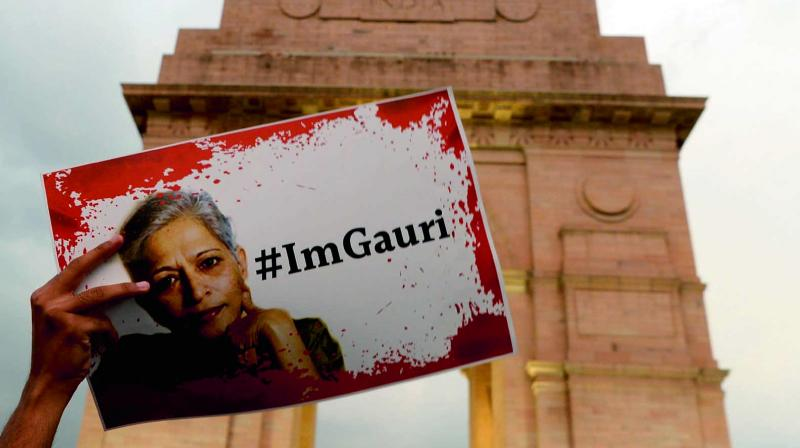 Activists take part in a protest rally against the killing of journalist Gauri Lankesh at India Gate. (Photo: AFP)