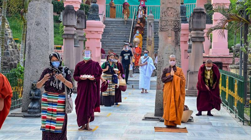 Devotees at the Bodh Gaya temple after it reopened on Sunday. (PTI)
