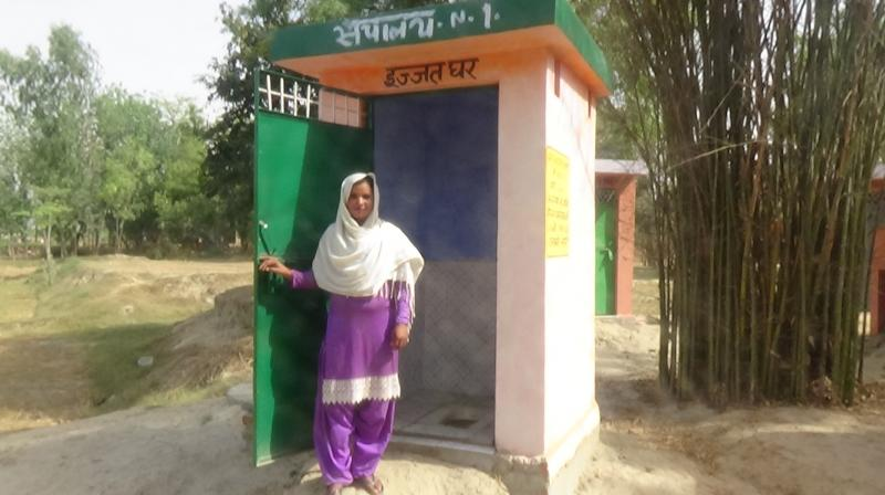 The last to construct a toilet at Kamli was Husna, who was extremely poor. The community helped her with  construction, and today it is as good as any in the village.