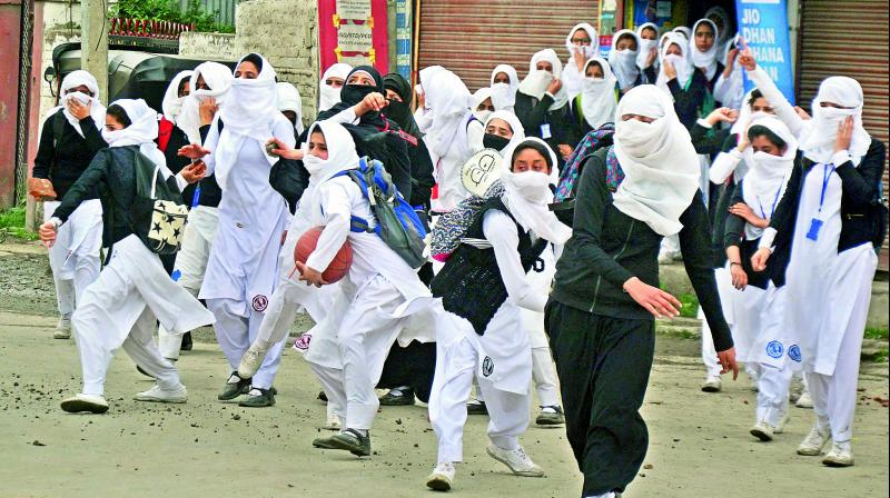 Girl students pelt stones at security personnel during clashes in the vicinity of Lal Chowk in Srinagar on Monday. (Photo: PTI/File)