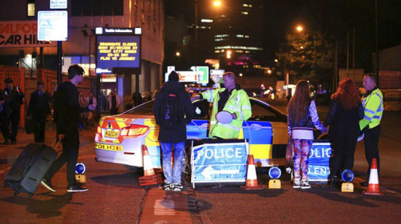 Emergency services work at Manchester Arena after reports of an explosion at the venue during an Ariana Grande gig in Manchester, England, Monday. (Photo: PTI)
