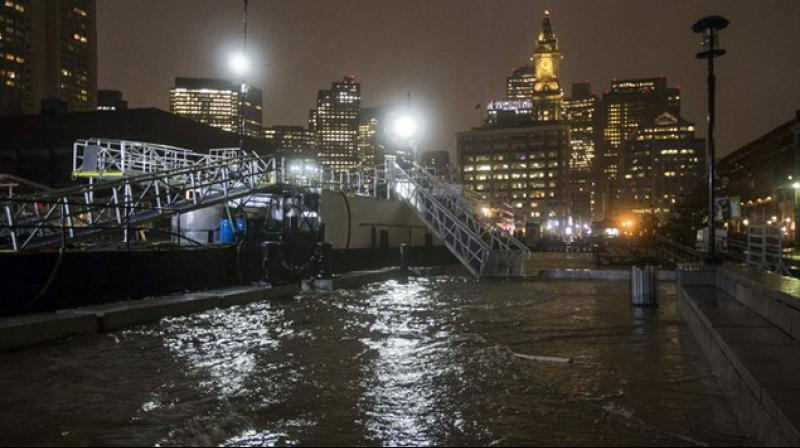 In Boston and nearby coastal communities, storm surges and high tides sent seawater in the streets, the second floods there this year. (Photo: AFP)