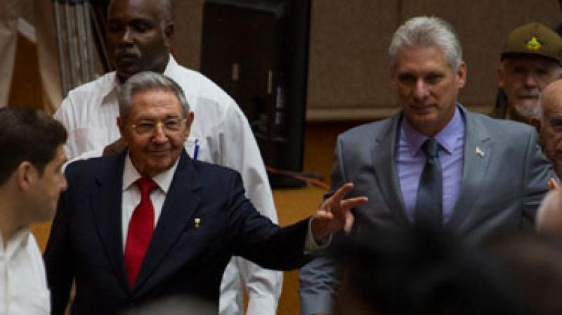 Cuba's President Raul Castro (L) enters the National Assembly followed by his successor Miguel Diaz-Canel. (Photo: AP)