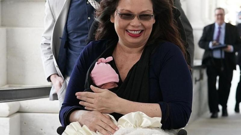 US senator Tammy Duckworth arrives at the US Capitol with her newborn baby daughter Maile Pearl Bowlsbey for a vote on the Senate floor on Capitol Hill in Washington. (Photo: AFP)