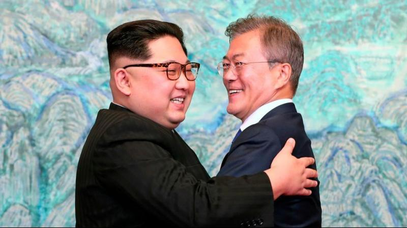 North Korean leader Kim Jong Un, left, and South Korean President Moon Jae-in embrace each other after signing a joint statement at the border village of Panmunjom in the Demilitarized Zone, South Korea on April 28. (Photo: AP/File)