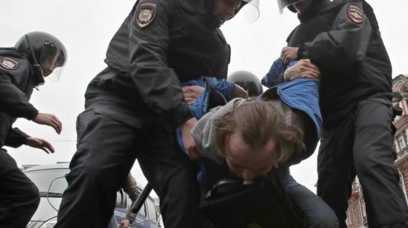 Russian police detain a protester at a demonstration against President Vladimir Putin in St.Petersburg, Russia, Saturday, May 5, 2018. A group that monitors political repression in Russia says more than 350 people have been arrested in a day of nationwide protests against the upcoming inauguration of Vladimir Putin for a new six-year term as president. (Photo: AP)