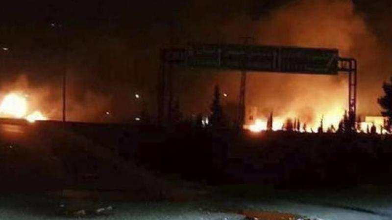This photo released on May 9, 2018, by the Syrian official news agency SANA, shows flames rising after an attack in Kisweh, south of Damascus, Syria -- an area known to have numerous Syrian army military bases. (Photo: AP)