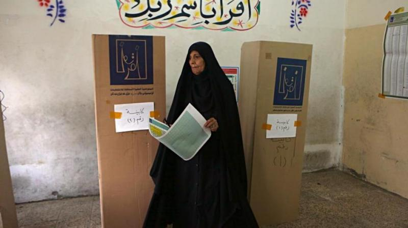 An Iraqi woman prepares to cast her vote in the country's parliamentary elections in Baghdad, Iraq, Saturday, May 12, 2018. (Photo: AP)