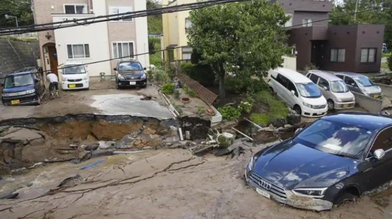 Cars are stuck in mud covered road after an earthquake in Sapporo, Hokkaido, northern Japan, Thursday, Sept. 6, 2018. (Photo: AP)