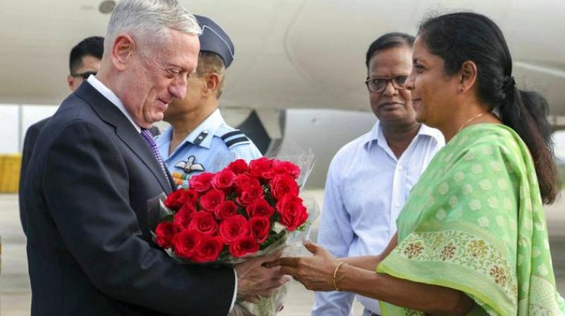 Defence Minister Nirmala Sitharaman presents bouquet to US Secretary of Defence James Mattis on his arrival in Delhi, to attend India's first ever '2+2 Dialogue' between the two nations. (Photo: PTI)