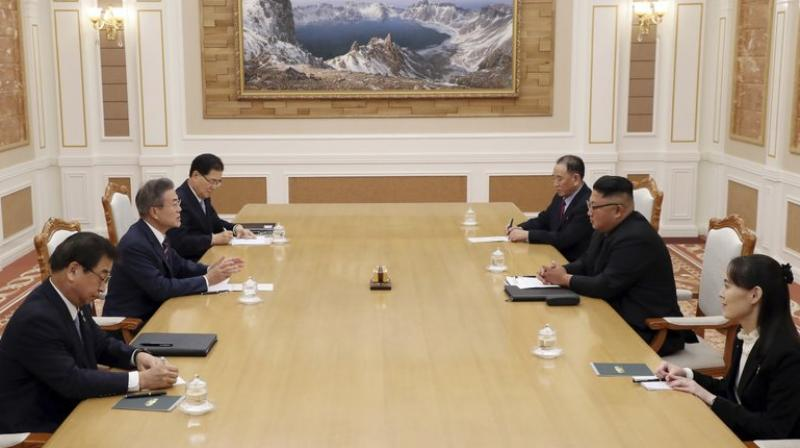 North Korean leader Kim Jong Un, right center, talks with South Korean President Moon Jae-in, left center, during their summit at the headquarters of the Central Committee of the Workers' Party in Pyongyang, North Korea, Tuesday, Sept. 18, 2018.  (Photo: AP)