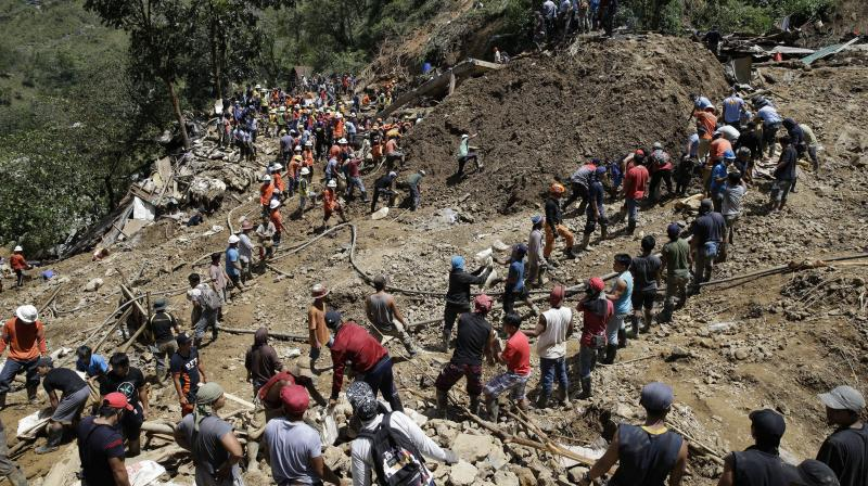 Dozens of people believed buried in the landslide probably did not survive, the mayor of Itogon said Monday, although rescuers kept digging through mud and debris covering a chapel where they had taken shelter. (Photo: AP)