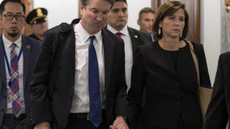 Supreme Court nominee Brett Kavanaugh and his wife Ashley Estes Kavanaugh depart after testifying before the Senate Judiciary Committee on Capitol Hill in Washington, Sept. 27, 2018. (Photo: AP)