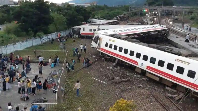 The government said the train had been carrying 366 people, and the Central News Agency said more than 30 were still trapped on board. (Photo: AP)