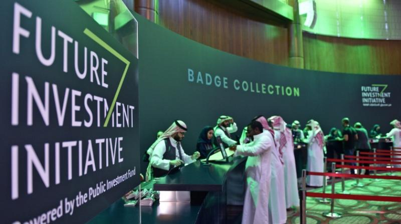 Saudi journalists collect their press badges for the Future Investment Initiative -- a key gathering overshadowed by the killing of critic Jamal Khashoggi. (Photo: AFP)