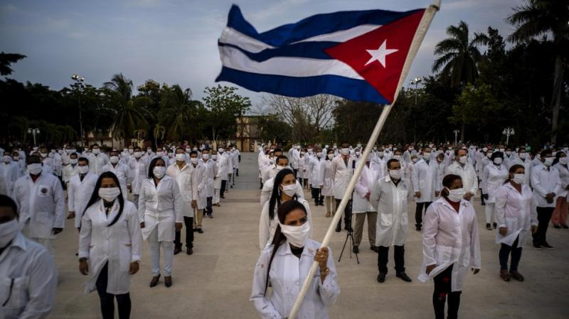 A brigade of health professionals, who volunteered to travel to South Africa to assist local authorities with an upsurge of coronavirus cases, attend the farewell ceremony in Havana, Cuba. (AP)