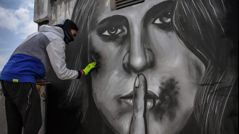 Graffiti art inspired by the increase in cases of domestic violence amid a lockdown aimed at curbing the spread of the COVID-19 pandemic. (AFP)