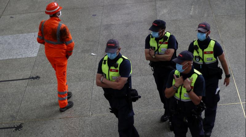 Security stuff wearing face masks to protect against the spread of the coronavirus at the central station in Munich, Germany. (AP)