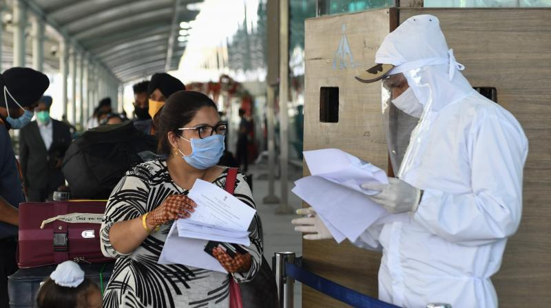 Security personnel check documents of travellers at an airport. (AFP)
